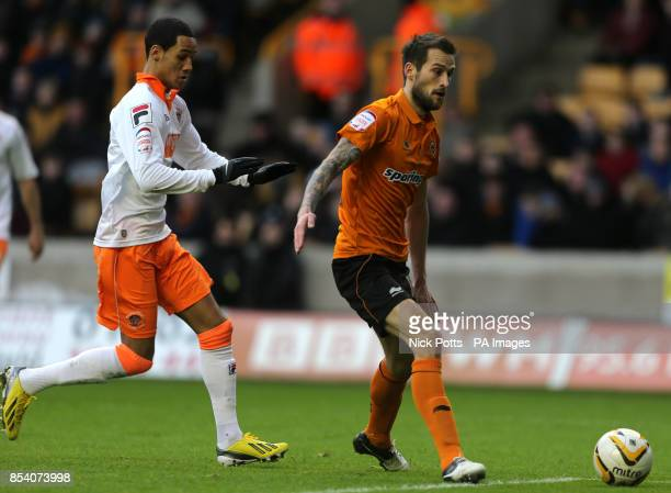 Wolverhampton Wanderers' defender Roger Johnson trys to shield the ball out of play but Blackpool's Thomas Ince nips in to score the 1st of two goals...