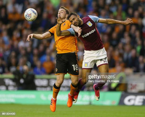 Wolverhampton Wanderers' Diogo Teixeira da Silva and Aston Villa's Ahmed Elmohamady clash for the ball during the Sky Bet Championship match at...