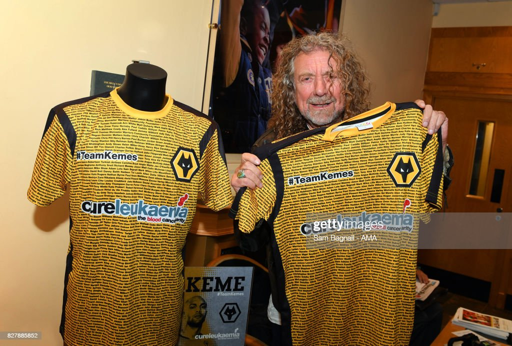 Wolverhampton Wanderers fan and Led Zeppelin singer, Robert Plant with a Charity shirt for Carl Ikeme of Wolverhampton Wanderers prior to the Sky Bet Championship match between Wolverhampton and Middlesbrough at Molineux on August 5, 2017 in Wolverhampton, England.