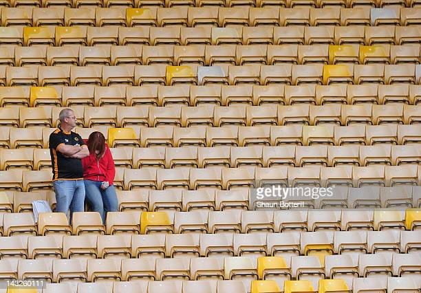 Wolverhampton Wanderers fans are dejected at the end of the Barclays Premier League match between Wolverhampton Wanderers and Manchester City at...