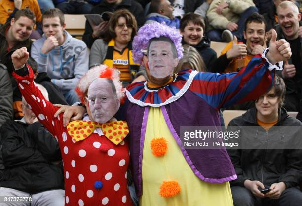 Wolverhampton Wanderers' fans Brett and Kerry Ralph dress up as clowns with face masts of Steve Morgan Chairman and Jez Moxey CEO during the Barclays...