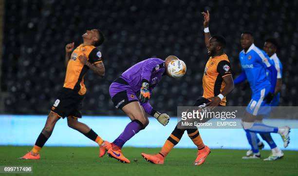 Wolverhampton Wanderers' goalkeeper Carl Ikeme drops the ball allowing Hull City's Adama Diomande to score the first goal