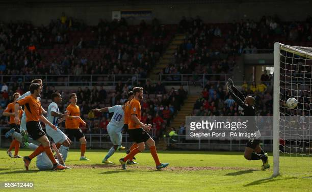 Wolverhampton Wanderers' goalkeeper Carl Ikeme fails to save Coventry City's Nathan Delfouneso from scoring the equalising goal during the Sky Bet...