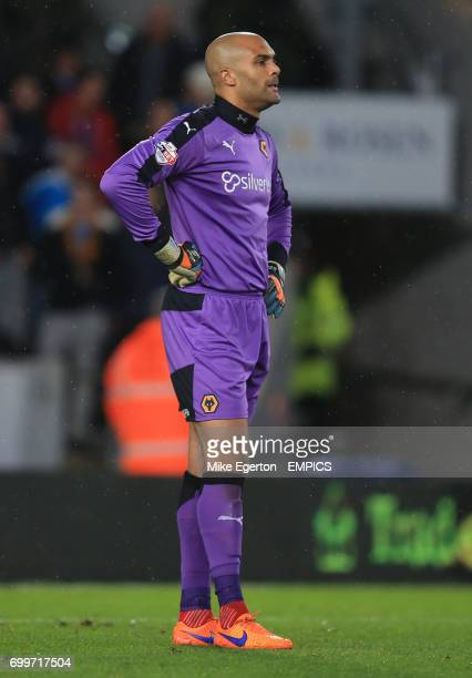 Wolverhampton Wanderers' goalkeeper Carl Ikeme stands dejected after he drops the ball allowing Hull City's Adama Diomande to score the first goal
