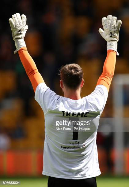 Wolverhampton Wanderers' goalkeeper Will Norris wears a shirt in support of teammate Carl Ikeme during the Sky Bet Championship match at Molineux...
