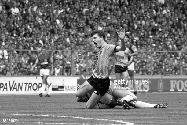 Wolverhampton Wanderers' goalscorer Andy Mutch is brought down by Burnley's Steve Davis