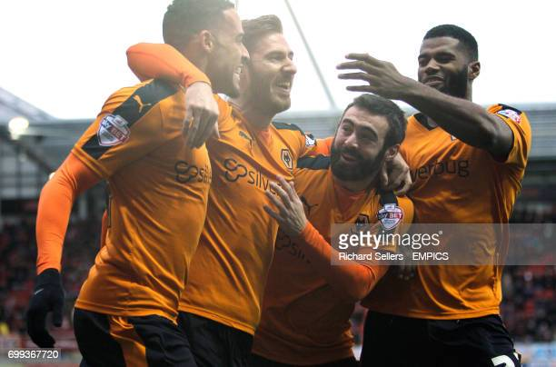 Wolverhampton Wanderers goalscorer James Henry centre with teammates Jack Price right and Jordan Graham as he celebrates the opening goal
