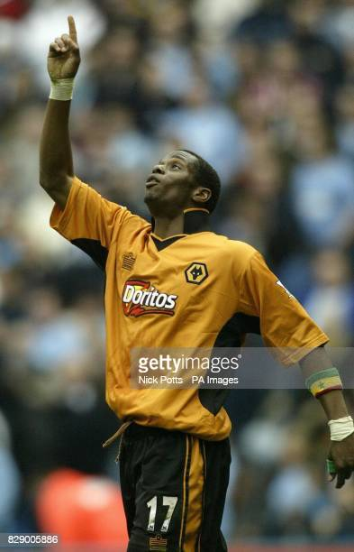 Wolverhampton Wanderers' Henri Camera celebrates by pointing his finger to sky after scoring goal that put Wolves 32 up only for Manchester City's...