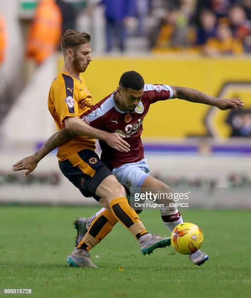 Wolverhampton Wanderers' James Henry and Burnley's Andre Gray battle for the ball