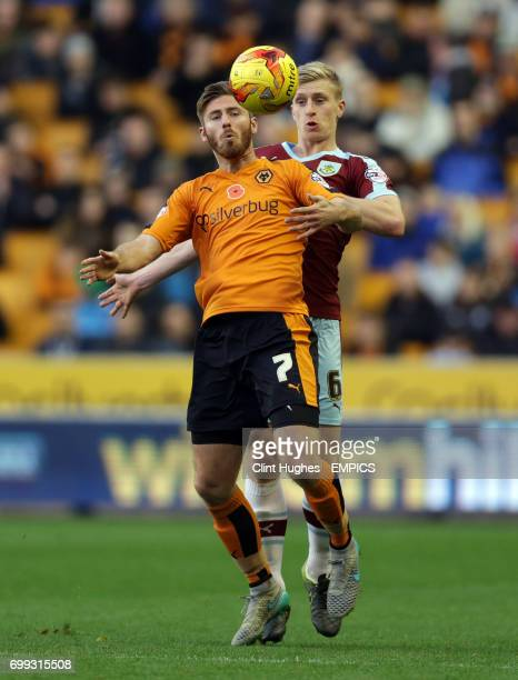 Wolverhampton Wanderers' James Henry and Burnley's Ben Mee battle for the ball