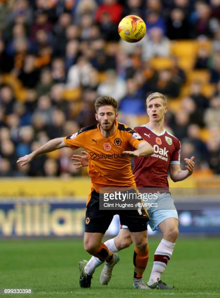 Wolverhampton Wanderers' James Henry and Burnley's Ben Mee battle for the ball in the air