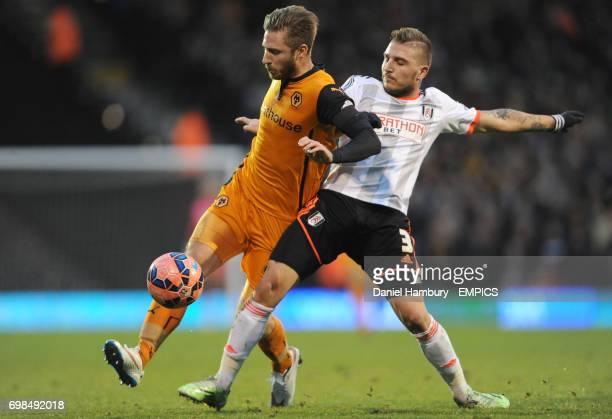 Wolverhampton Wanderers' James Henry and Fulham's Kostas Stafylidis battle