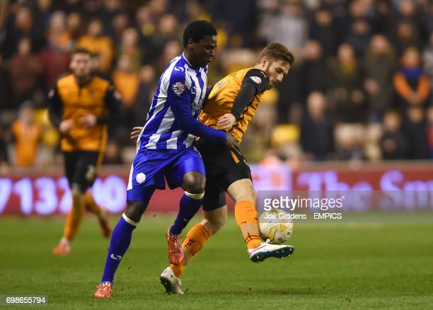 Wolverhampton Wanderers' James Henry and Sheffield Wednesday's Jeremy Helan battle for the ball