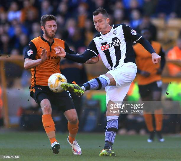 Wolverhampton Wanderers' James Henry and Watford's Daniel Tozser battle for the ball
