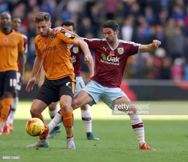 Wolverhampton Wanderers' James Henry is tackled by Burnley's George Boyd
