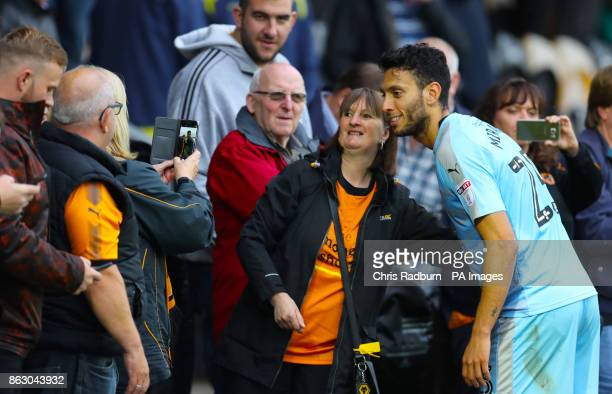 Wolverhampton Wanderer's Jefferson Roderick Miranda poses for a photograph with fans after the final whistle