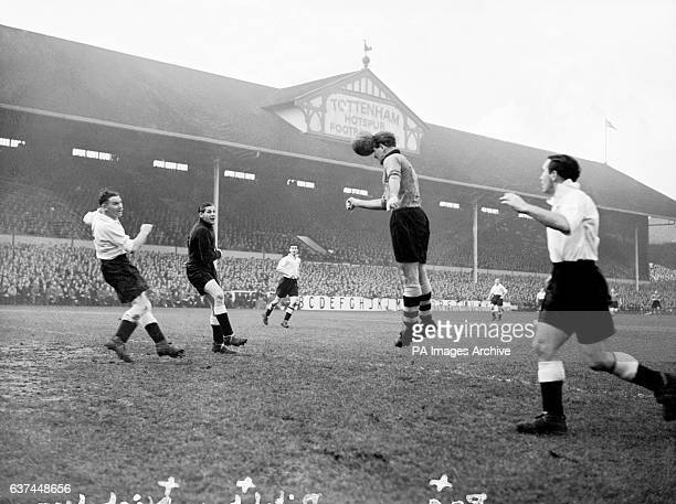 Wolverhampton Wanderers' Jesse Pye heads his team's first goal past Tottenham Hotspur's Bill Nicholson Ted Ditchburn and Alf Ramsey