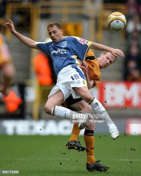 Wolverhampton Wanderers' Jody Craddock battles for the ball with Cardiff City's Michael Chopra