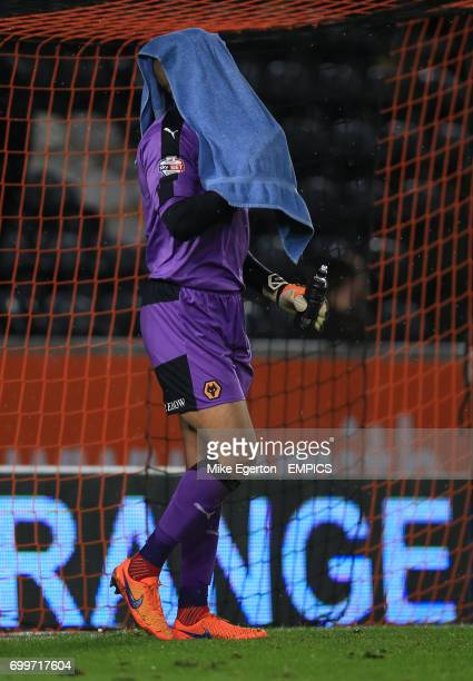 Wolverhampton Wanderers' keeper Carl Ikeme stands dejected at half time