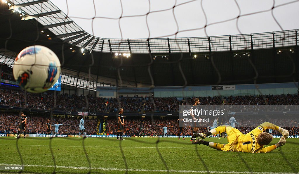 Wolverhampton Wanderers keeper Wayne Hennessey is beaten for the third goal scored by <a gi-track='captionPersonalityLinkClicked' href=/galleries/search?phrase=Adam+Johnson+-+Soccer+Player&family=editorial&specificpeople=6720094 ng-click='$event.stopPropagation()'>Adam Johnson</a> of Manchester City during the Barclays Premier League match between Manchester City and Wolverhampton Wanderers at Etihad Stadium on October 29, 2011 in Manchester, England.