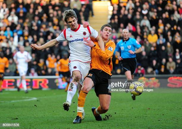Wolverhampton Wanderers' Kevin Doyle and Hull City's Tom Cairney battle for the ball
