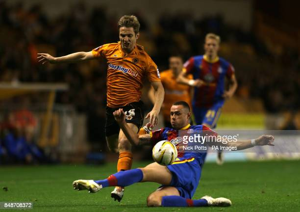 Wolverhampton Wanderers' Kevin Doyle skips over challenge from Crystal Palace's Damien Delaney during the npower Championship match at the Molineux...