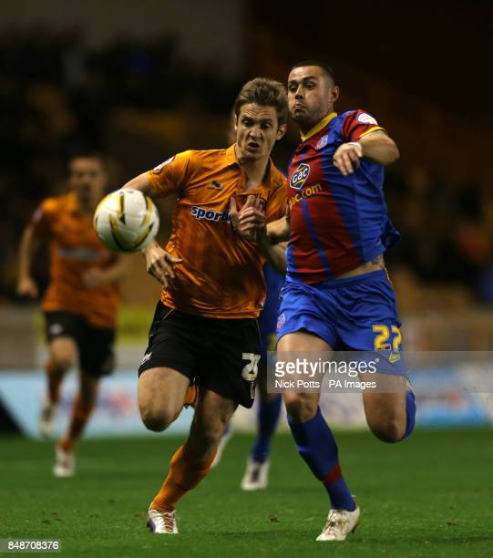 Wolverhampton Wanderers' Kevin Doyle tussles for the ball with Crystal Palace's Damien Delaney during the npower Championship match at the Molineux...