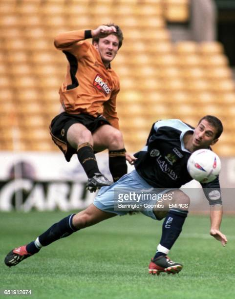 Wolverhampton Wanderers' Lee Naylor and Burnley's Dimitrios Papadopoulos battle for the ball