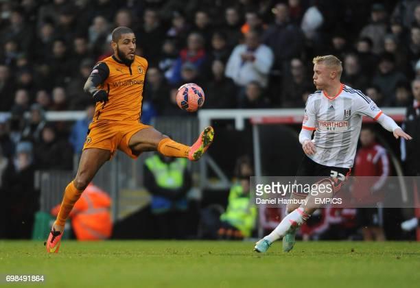 Wolverhampton Wanderers' Leon Clarke and Fulham's Lasse Vigen Christensen battle for the ball