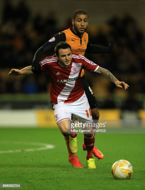 Wolverhampton Wanderers' Leon Clarke and Middlesbrough' s Lee Tomlin battle for the ball