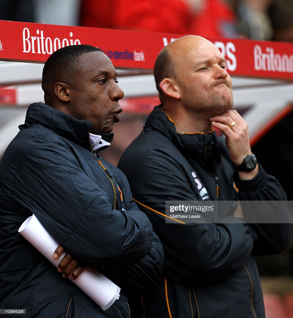 Wolverhampton Wanderers Manager Terry Connor and Assistant Steve Weaver (R) look on during the Barclays Premier League match between Stoke City and Wolverhampton Wanderers at the Britannia Stadium on April 7, 2012 in Stoke on Trent, England.