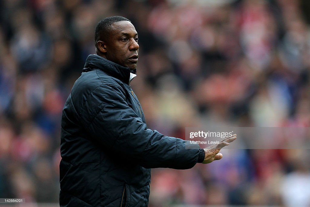 Wolverhampton Wanderers Manager Terry Connor gestures during the Barclays Premier League match between Stoke City and Wolverhampton Wanderers at the Britannia Stadium on April 7, 2012 in Stoke on Trent, England.