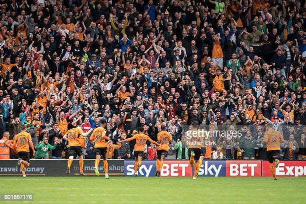 Wolverhampton Wanderers players and fans celebrate after Prince Oniangue scored the opening goal during the Sky Bet Championship match between...
