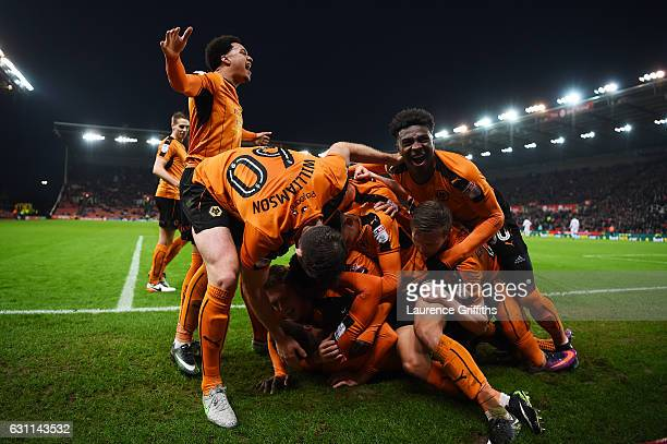 Wolverhampton Wanderers players celebrate their team's second goal scored by Matt Doherty during The Emirates FA Cup Third Round match between Stoke...