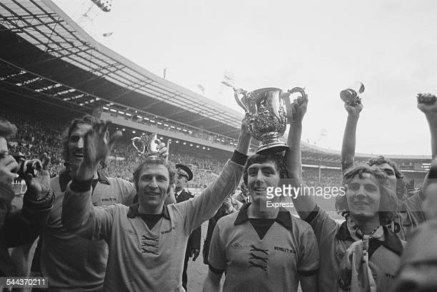 Wolverhampton Wanderers players with the trophy after beating Manchester City in the Football League Cup Final at Wembley Stadium London 23rd...