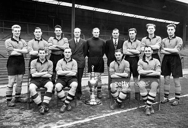 Wolverhampton Wanderers with the League Championship trophy circa August 1954 Back row left to right Ron Flowers Bill Shorthouse Eddie Stuart Stan...