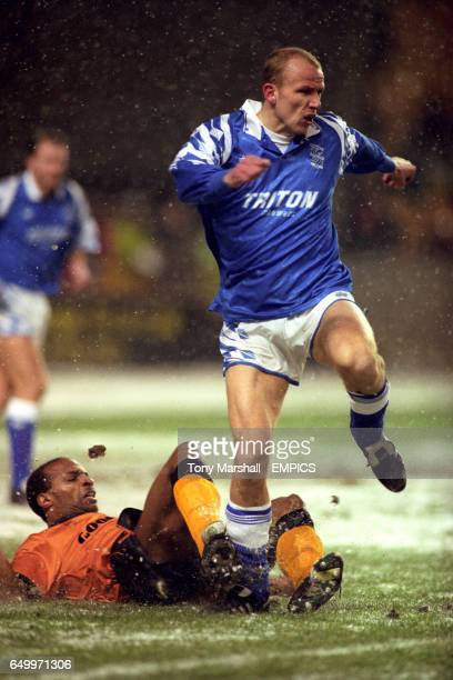 Wolverhampton Wanderers's Cyrille Regis tries a sliding tackle on Birmingham City's Kenny Lowe