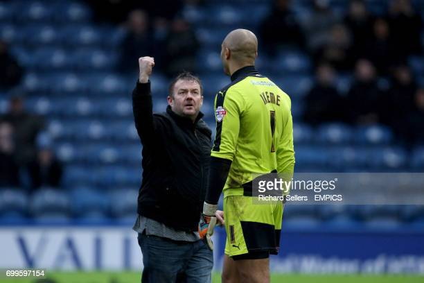 Wolves fan confronts Wolverhampton Wanderers goalkeeper Carl Ikeme on the pitch