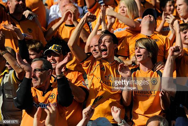 Wolves fans celebrate victory on the final whistle of the Barclays Premier League match between Wolverhampton Wanderers and Fulham at Molineaux on...