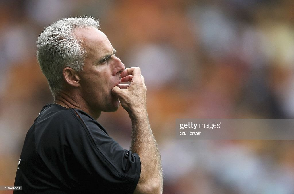 Wolves manager Mick McCarthy watches from the sidelines during the Pre-season friendly match between Wolverhampton Wanderers and Aston Villa at Molineux on July 29, 2006 in Wolverhampton, England.