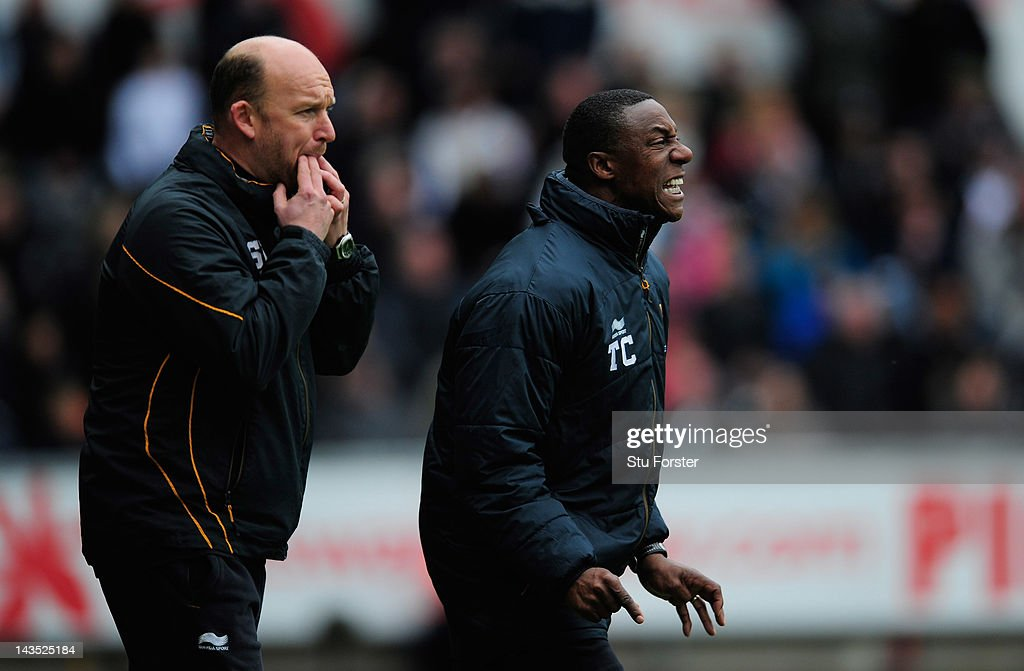 Wolves manager Terry Connor (r) reacts during the Barclays Premier league match between Swansea City and Wolverhampton Wanderers at Liberty Stadium on April 28, 2012 in Swansea, Wales.