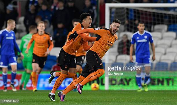 Wolves player Matt Doherty celebrates with team mates after scoring the opening goal during the Sky Bet Championship match between Cardiff City and...