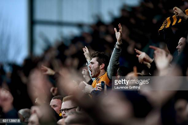 Wolves supporters celebrate their sides first goal during The Emirates FA Cup Third Round match between Stoke City and Wolverhampton Wanderers at...