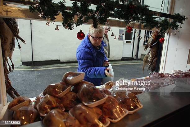 A woma shops at Andrew Francis butchers in the rural town of Ludlow in Shropshire on December 8 2011 in Ludlow England With a weak outlook at the...