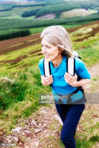 Woman 50-59 years, hiking with backpack
