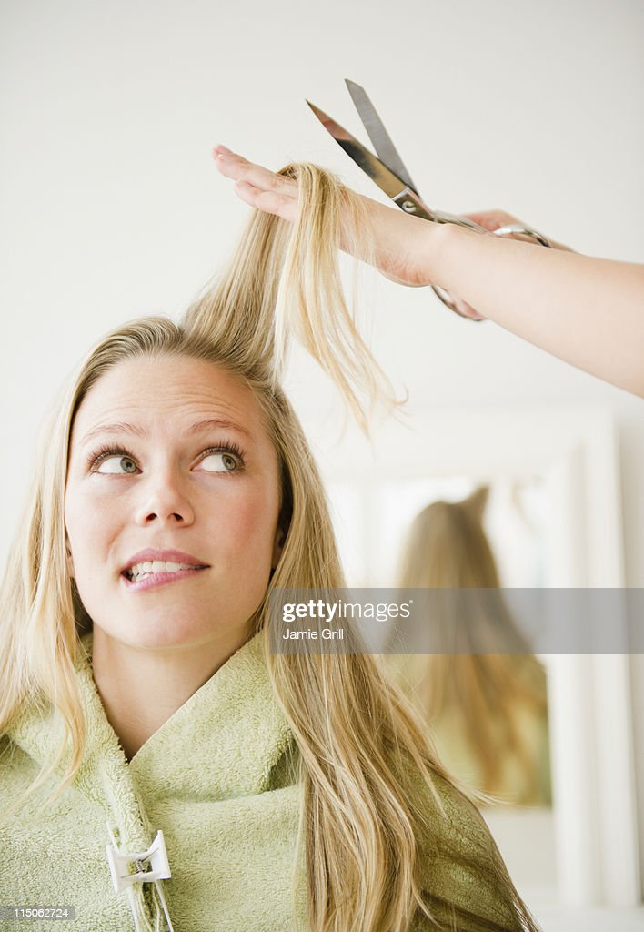 Woman about to get her haircut : Stock Photo