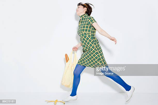 Woman about to slip on banana skin