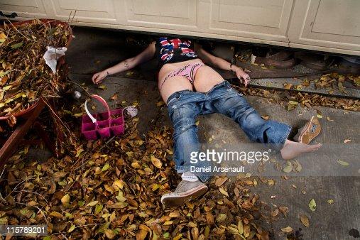 Woman, accident under garage door. : Stock Photo