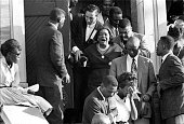 A woman accompanied by a number of other people sobs as she exits a funeral for victims of the 16th Street Baptist Church bombing in Birmingham...