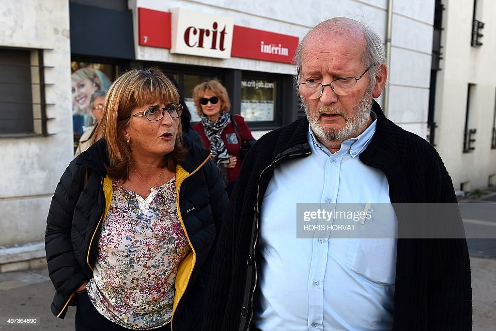 A woman addresses Poly Implant Prothese (PIP) founder Jean-Claude Mas (R) as he arrives to the courthouse on November 16, 2015 in Aix-en-Provence, for his appeal trial, after having been sentenced in an initial trial to four years of imprisonment for allegedly selling faulty breast implants that sparked global health fears. PIP company was shut down on March 2010 and its product banned after it was revealed to have been using non-authorised silicone gel that caused abnormally high rupture rates of its implants. AFP PHOTO / BORIS HORVAT